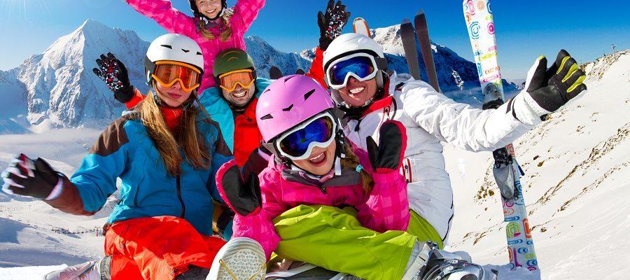 Skiing,,Winter,,Snow,,Sun,And,Fun,-,Family,Enjoying,Winter